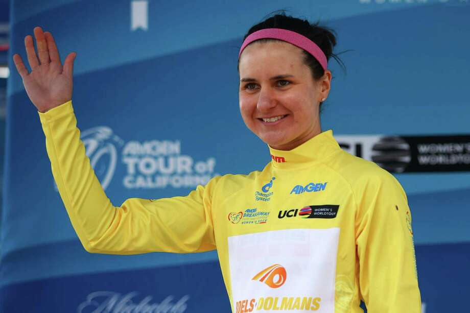 SOUTH LAKE TAHOE, CA - MAY 19:  Megan Guarnier of the United States riding for the Boels-Dolmans Cycling Team celebrates on the podium as she receives the yellow race leader's jersey after winning stage one of the Amgen Breakaway from Heart Disease Women's Race on May 19, 2016 in South Lake Tahoe, California.  (Photo by Chris Graythen/Getty Images) ORG XMIT: 631317525 Photo: Chris Graythen / 2016 Getty Images
