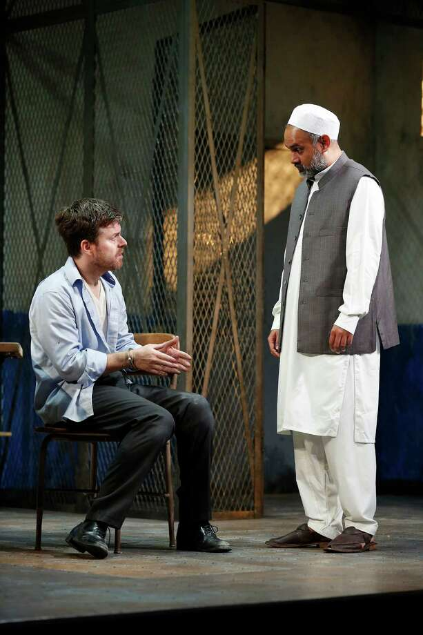 "Eric Bryant, left, and Rajesh Bose in a scene from ""The Invisible Hand,"" by Ayad Akhtar, at the Westport Country Playhouse through Aug.6. Photo: Carol Rosegg / Contributed Photo / Connecticut Post Contributed"
