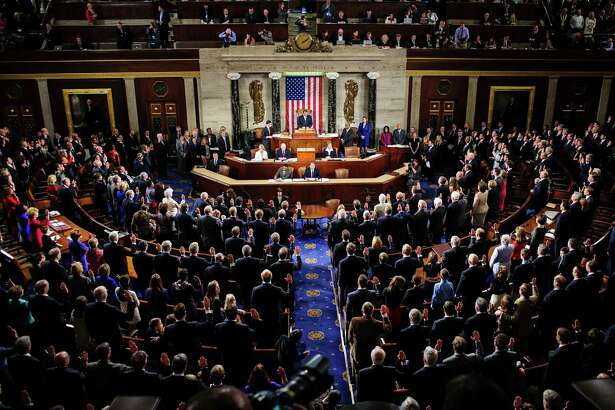 The number of U.S. House members has been stuck at 435 since 1913. Members are sworn in at the U.S. Capitol in Washington, D.C., U.S., on Jan. 3, 2013.