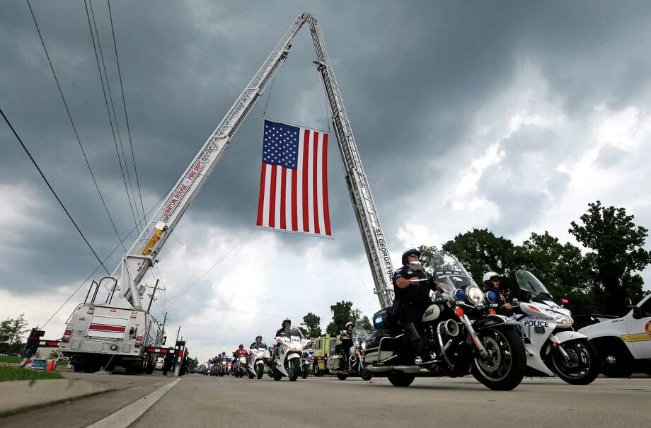 Police motorcycles lead the procession to a cemetery after funeral services for Baton Rouge police officer Matthew Gerald in July. A survivor of the shooting, Nick Tullier, is being transferred to Houston for further treatment. Click through for more on police shootings in Texas. Photo: Gerald Herbert, STF / Copyright 2016 The Associated Press. All rights reserved. This material may not be published, broadcast, rewritten or redistribu