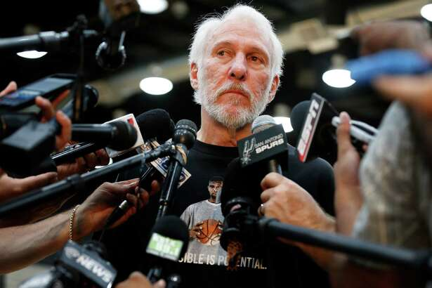 Wearing a T-shirt with the image of Tim Duncan, Spurs coach Gregg Popovich is both proud and wistful as he talks to the media about the departure of his beloved player. Readers feel the same way.
