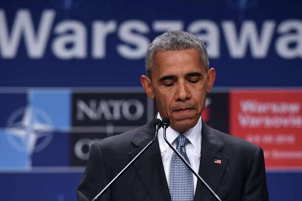 President Barack Obama pauses while speaking about the events in Dallas at the beginning of his news conference at PGE National Stadium in Warsaw, Poland, on July 9. He ignores a central fact — blacks proportionately commit more violent crimes.