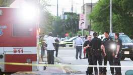 Houston police investigate at a crime scene. Gov. Greg Abbott's proposal to make assaults on police officers that are committed out of anti-police bias hate crimes has merit and should be passed.