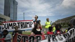 "Protesters hold ""Dump Trump"" and ""Stop Trump"" signs while demonstrating during the Republican National Convention (RNC) in Cleveland, Ohio. A reader says the stop Trump effort was offensive."
