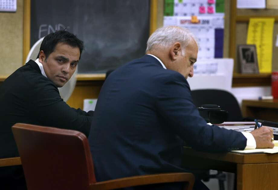 Tech mogul Gurbaksh Chahal, accused of two similar beatings, sits with attorney James Lassart in court F. Photo: Paul Chinn, The Chronicle