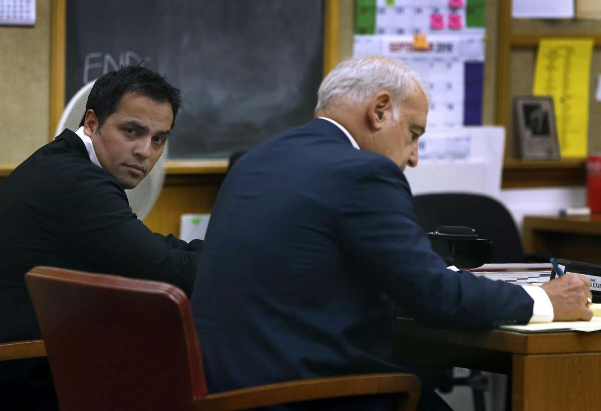 Tech mogul Gurbaksh Chahal sits with his attorney James Lassart during a hearing to consider revocation of his probation on domestic violence charges in San Francisco, Calif. on Friday, July 22, 2016.