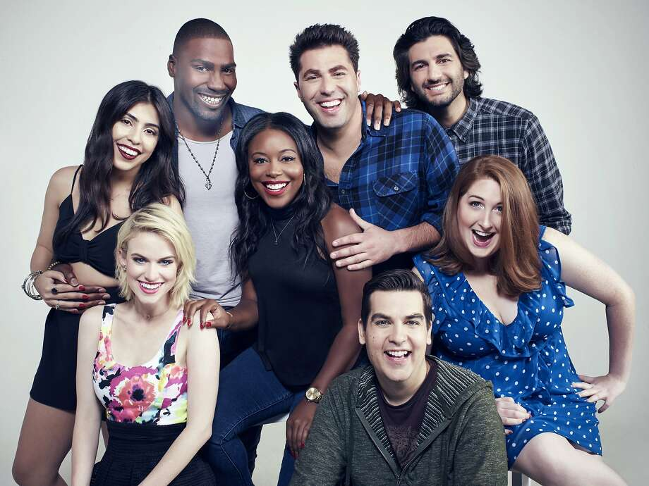 "Jeremy D. Howard (back row, left) is one of the young comics starring in the CW's new ""MADtv"" premiering July 26 on the CW.  Next to him are:  Adam Ray, and Amir K. (Middle row left to right): Michelle Ortiz, Lyric Lewis, and Chelsea Davison. (Front row left to right): Carlie Craig and Piotr Michael. (Tommy Garcia/The CW) Photo: Tommy Garcia/The CW, TNS"