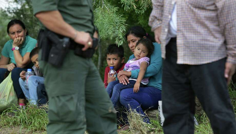 Immigrant mothers sit with their children after they were apprehended near Fronton. This massive flow of immigrant families is   costly to the U.S.  Attacking its root causes is necessary. Photo: Bob Owen / San Antonio Express-News / ©2016 San Antonio Express-News