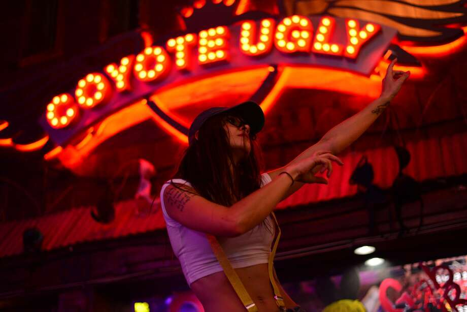 The Coyote Ugly Saloon Saloon on the San Antonio River Walk celebrated its 12th anniversary with an Emoji costume party on Thursday, July 21, 2016. Photo: Kody Melton