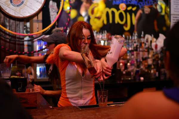 The Coyote Ugly Saloon Saloon on the San Antonio River Walk celebrated its 12th anniversary with an Emoji costume party on Thursday, July 21, 2016.