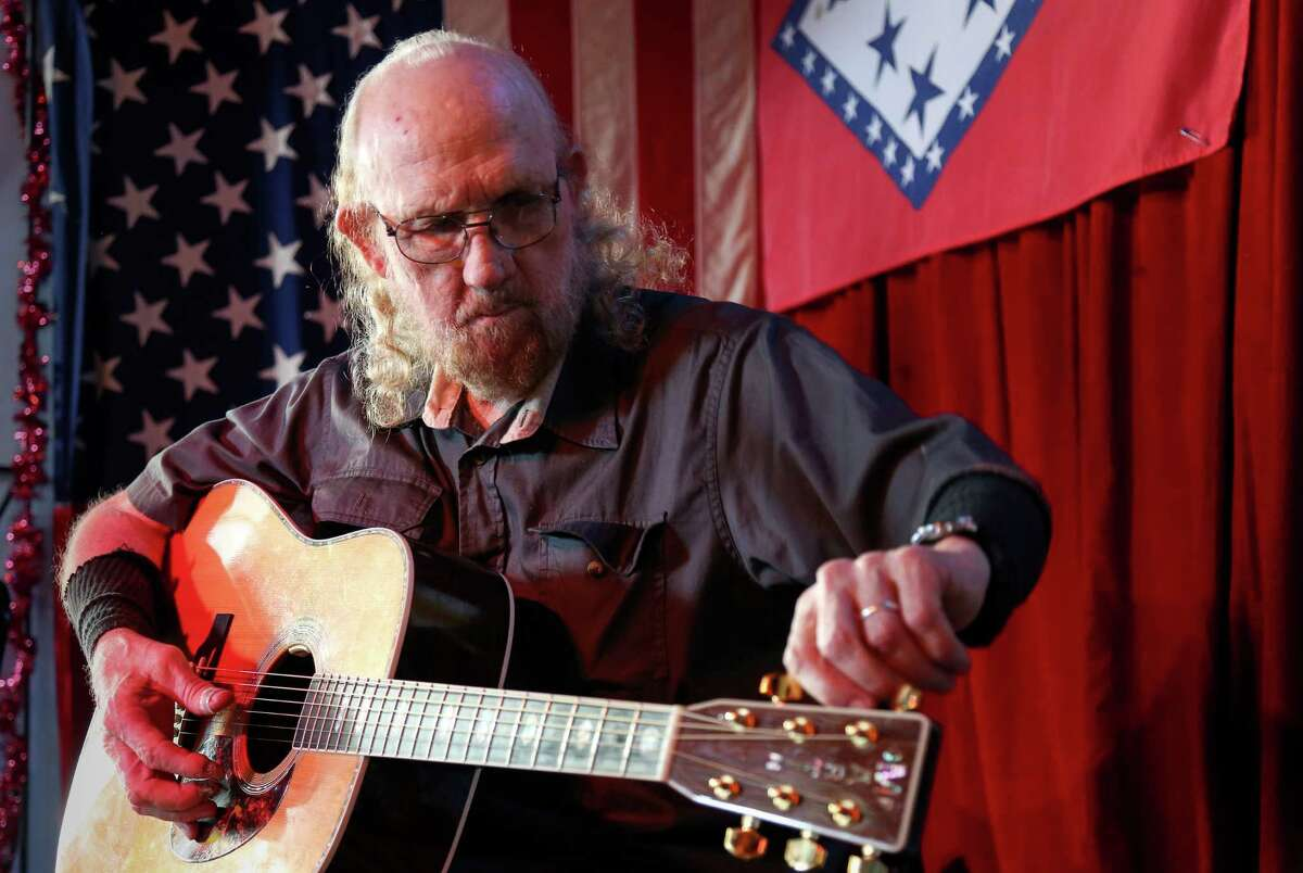 Rex Bell performs an impromptu session at the Old Quarter Acoustic Cafe, Thursday, June 9, 2016, in Galveston. Bell, who played with music legends like Townes Van Zandt and Lightnin' Hopkins, plans to sell the storied folk club. ( Jon Shapley / Houston Chronicle )