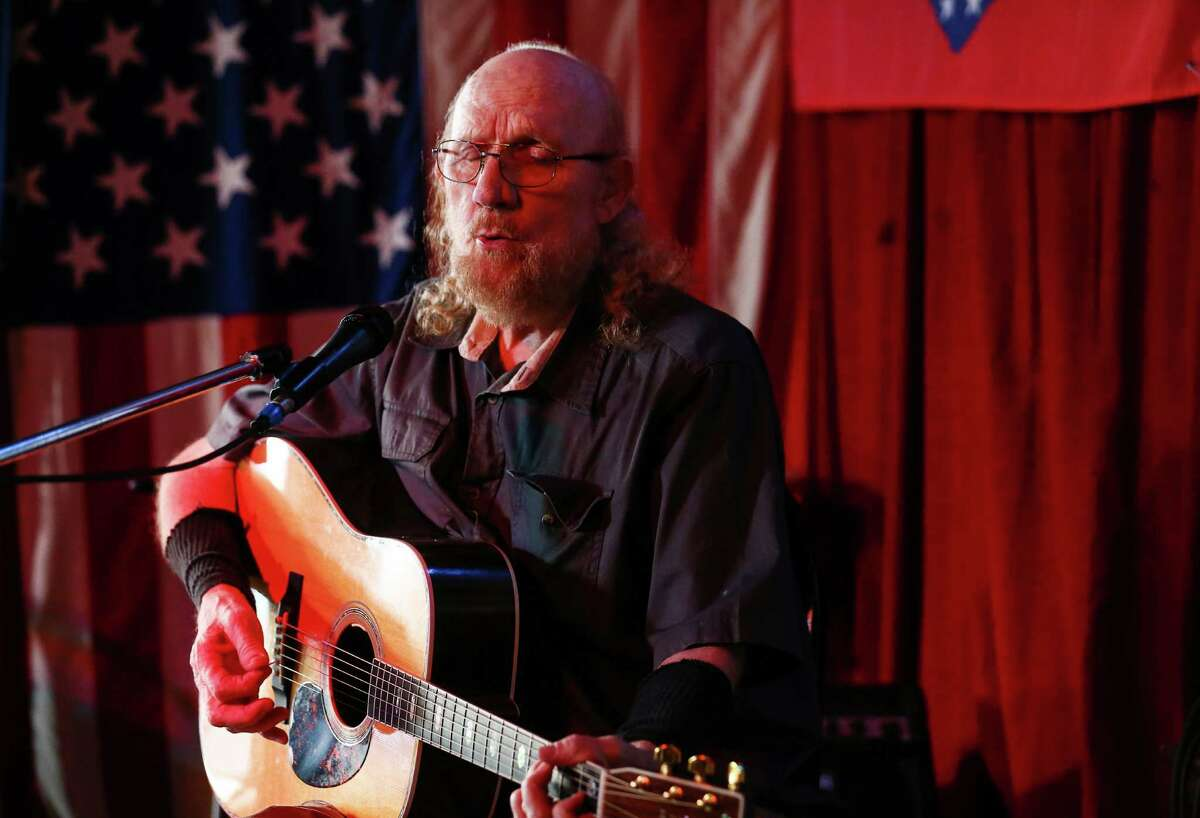 Rex Bell, who played with music legends including Townes Van Zandt and Lightnin' Hopkins, plans to sell his folk club, Old Quarter Acoustic Cafe, whose walls, above, are graced with posters from decades of shows.