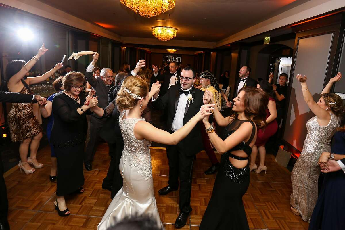 Laleh Emiley and Sam Elayyoub held their wedding reception at the Silicon Valley Capital Club, and it included a zaffa, a musical processional with drums, a belly dancer, as per Jordanian custom, and baklava. There were also sparklers.