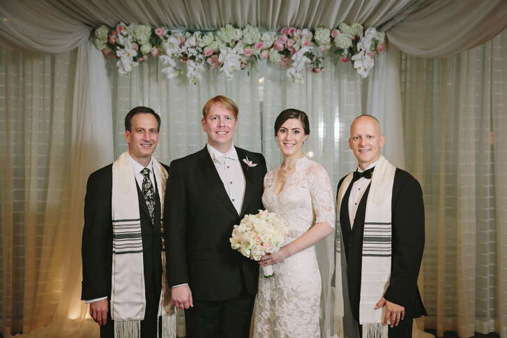 Scott and Cheryl  Looper, center, married last year at the Petroleum Club two months after the  Memorial Day floods. Instead of favors, they  made a contribution in their guests' names to the Jewish Federation of Greater Houston's flood-relief fund.