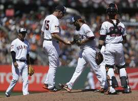San Francisco Giants pitcher Sergio Romo hands the ball to manager Bruce Bochy (15) as he is removed in the eighth inning of a baseball game against the Colorado Rockies, Monday, July 4, 2016, in San Francisco. (AP Photo/Ben Margot)