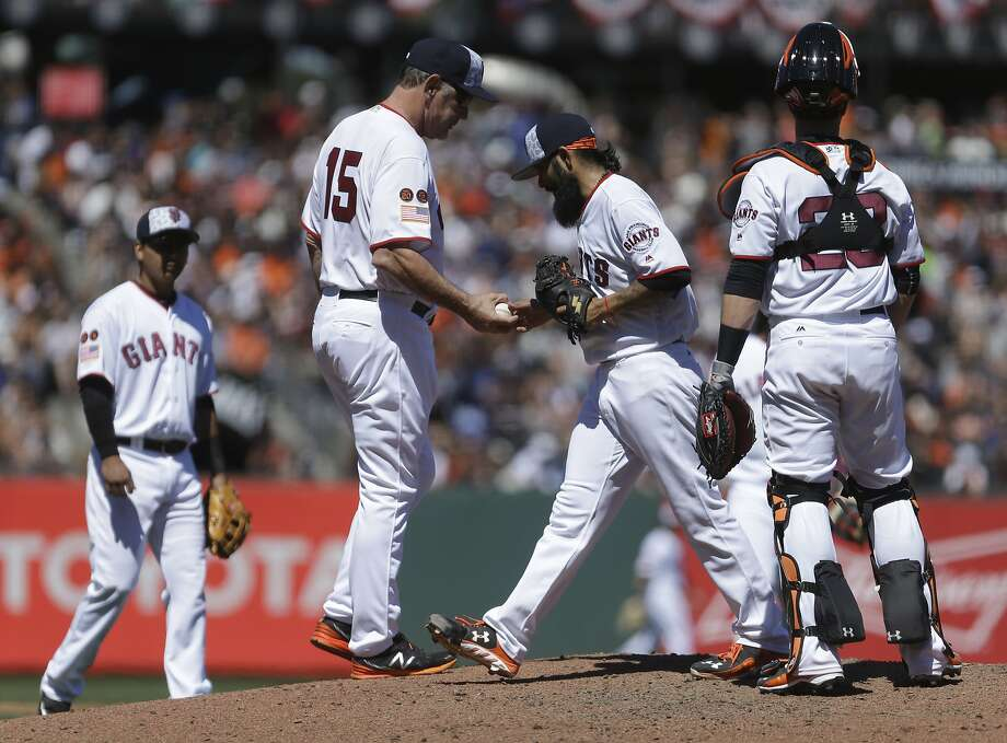 Bruce Bochy goes out to get reliever Sergio Romo — but wait, he hasn't faced the minimum required batters so Romo has to stay in. At least, if a proposed rule was enacted. Photo: Ben Margot, Associated Press