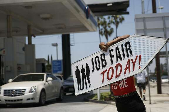 "An Aarrow Sign Spinners representative spins a ""Job Fair Today"" sign during a Choice Career Fair in Los Angeles, California, U.S., on Wednesday, June 22, 2016. The U.S. Department of Labor is scheduled to release initial jobless claims figures on June 23. Photographer: Patrick T. Fallon/Bloomberg"