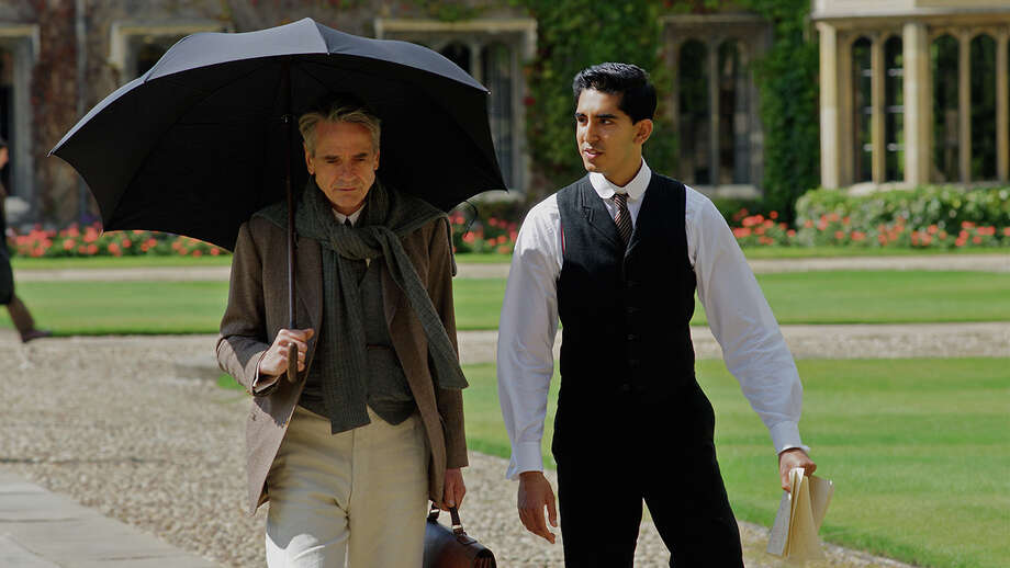 "Dev Patel, right, plays an Indian math genius who finds a mentor in Jeremy Irons in the based-on-fact World War I-era drama, ""The Man Who Knew Infinity."" Photo: Contributed Photo / Connecticut Post Contributed"
