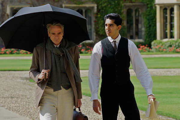 "Dev Patel, right, plays an Indian math genius who finds a mentor in Jeremy Irons in the based-on-fact World War I-era drama, ""The Man Who Knew Infinity."""