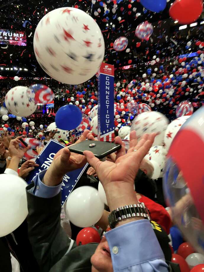 The Connecticut delegation celebrates at the end of the GOP Convention at Quicken Loans Arena in Cleveland, OH on Thursday, July 21, 2016. Photo: Neil Vigdor, Hearst Connecticut Media / Connecticut Post