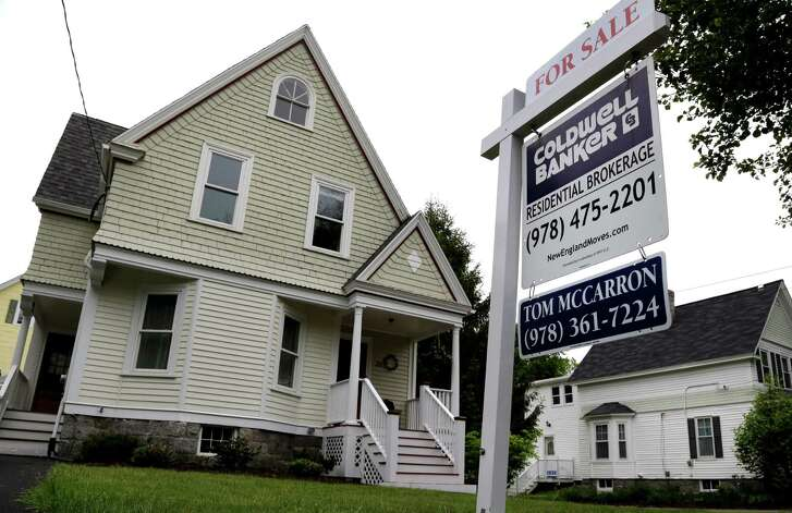 FILE - This Tuesday, May 24, 2016, file photo shows a home for sale in Andover, Mass. On Thursday, July 21, 2016, the National Association of Realtors reports on June sales of existing homes. (AP Photo/Elise Amendola, File)