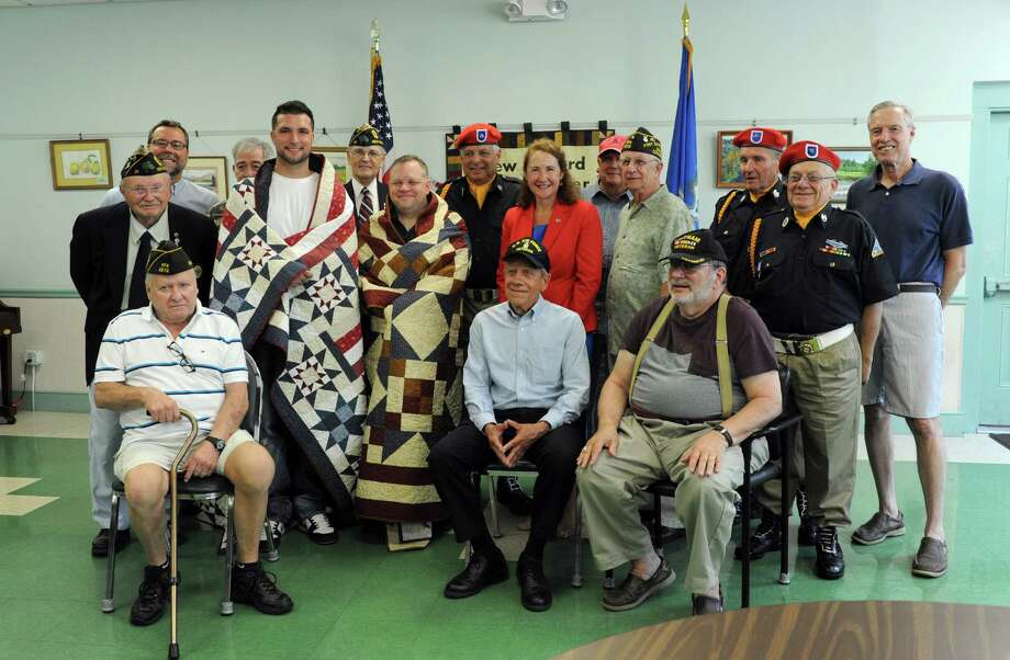 Veterans Mike Zacchea and Robert Madorran are presented with Quilts of Valor in a ceremony precided over by Congresswoman Elizabeth Esty and Mayor David Gronbach at the New Milford Senior Center Friday morning, July 22, 2016. Photo: Carol Kaliff / The News-Times