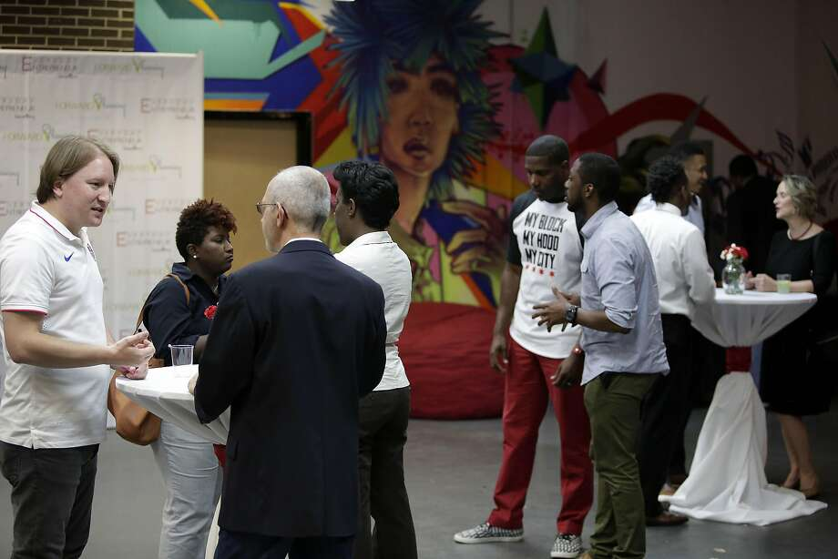 Guests attend a mixer to network with other entrepreneurs at Blue 1647, a nonprofit tech incubator, in Chicago, June 3, 2016. Blue1647 has trained more than 2,400 youths and adults in its sequential classes or 12-week boot camps, the majority of whom identify as black or Hispanic, part of a growing number of startups that have dedicated themselves to creating programs to train blacks and Hispanics for tech jobs. (Joshua Lott/The New York Times) Photo: JOSHUA LOTT, NYT
