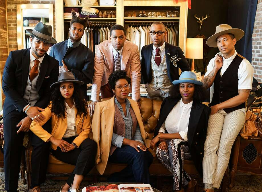 When dandies meet: Seen here at the Heart of Gold boutique in the Western Addition, from left (back row): Jordan Coffey, Julian Eison, Michael Wayne Turner. Front row: Dario Smith, Mimo Haile, Shawntee Edwards, Faiza Farah and shop owner Gene Barnes. Photo: Henny Garfunkel, Special To The Chronicle