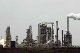 File photo of Andeavor refinery in Anacortes, Wash. Marathon Petroleum is buying San Antonio-based Andeavor for $23 billion, the companies announced Monday.