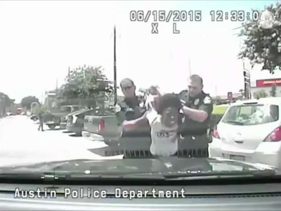 "In this June 15, 2015, frame from dash cam video, Breaion King is led by officers during a traffic stop in Austin, Texas. The black Texas teacher who was thrown to the ground by a white officer during the traffic stop, and then told by another white officer on the way to jail that blacks have ""violent tendencies,"" said Friday, July 22, 2016, she is grateful the police chief has publicly apologized. The footage released July 21, of the arrest is the latest in a string of videos showing tense encounters between police and blacks across the country. (Austin Police Department via AP) Photo: Associated Press"