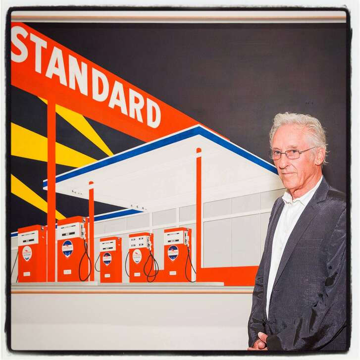 """Artist Ed Ruscha with his """"Standard Station, Amarillo, Texas, 1963"""" painting at the de Young opening for his exhibition. July 2016. By Drew Altizer."""