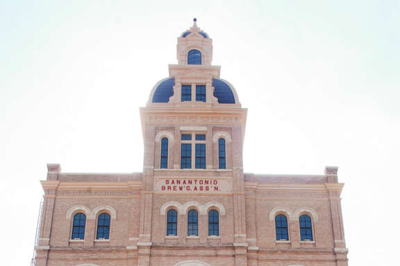 """The Pearl Brewery building where Southerleigh Fine Food & Brewery operates has signage that says """"SAN ANTONIO BREW'G ASS'N."""""""