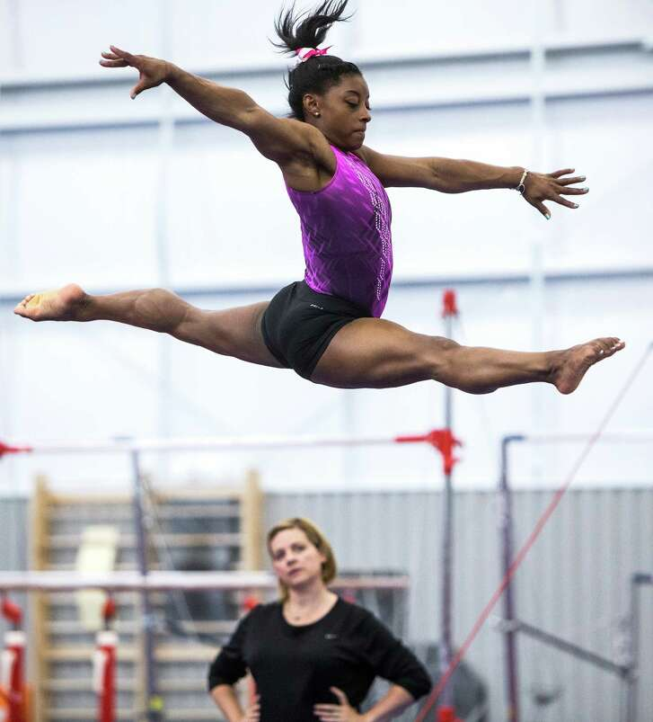 Gymnast Simone Biles works out as coach Aimee Boorman looks on at World Champion Centre in Houston. ( Brett Coomer / Houston Chronicle )