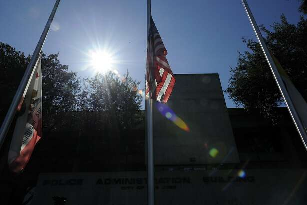 Flags file at half mast in front of the San Jose Police Department headquarters in San Jose, CA, on Wednesday, March 25, 2015.