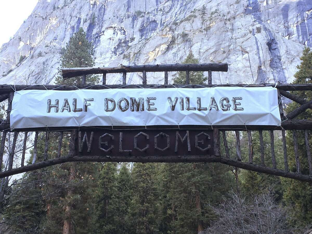 FILE - In a Tuesday, March 1, 2016 file photo, a sign for Half Dome Village is seen in Yosemite National Park, Calif.