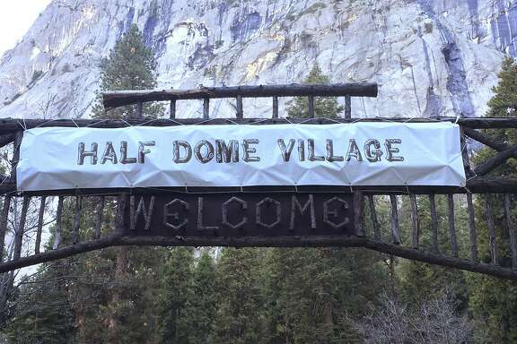 FILE -  In a Tuesday, March 1, 2016 file photo, a sign that used to welcome visitors to Curry Village now reads Half Dome Village, in Yosemite National Park, Calif. The National Park Service has asked a federal trademark board to cancel trademarks, including Curry Village, obtained by Delaware North, the company that previously ran the park's hotels, restaurants and outdoor activities, the Sacramento Bee reported Friday, March 18, 2016. Delaware North, is demanding the park service pay it $51 million for the names and other intellectual property and has filed a lawsuit in federal court. (Rory Appleton/The Fresno Bee via AP, File) LOCAL PRINT OUT (VISALIA TIMES-DELTA, REEDY EXPONENT, KINGBURG RECORDER, SELMA ENTERPRISE, HANFORD SENTINEL, PORTERVILLE RECORDER, MADERA TRIBUNE, THE BUSINESS JOURNAL FRENSO); LOCAL TELEVISION OUT (KSEE24, KFSN30, KGE47, KMPH26); MANDATORY CREDIT