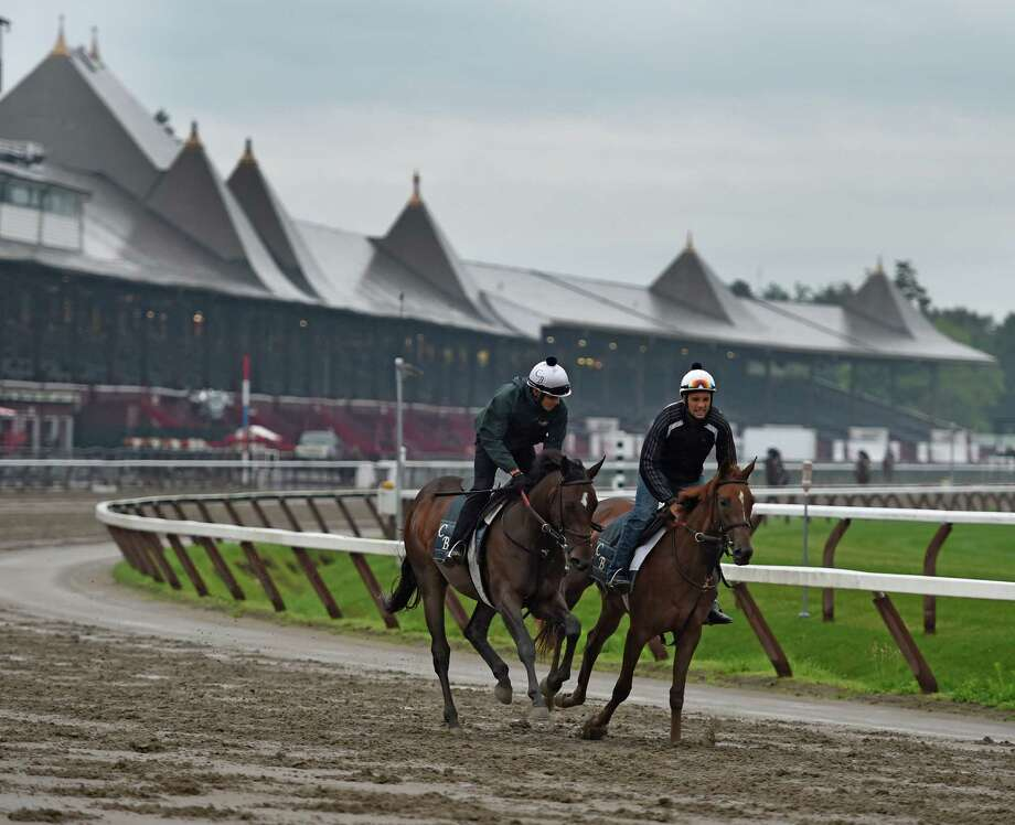 A set of Chad Brown trainees go out for their daily exercise on a muddy main track at the Saratoga Race Coruse as rain continues Wednesday morning July 1, 2015 in Saratoga Springs, N.Y.     (Skip Dickstein/Times Union) Photo: SKIP DICKSTEIN