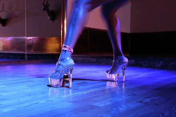 Krisyerkis Marivi Juarez, 30, dances at Barebacks Grill & Bar Gentlemans Club Thursday Aug. 4, 2011 in Encinal, TX. (PHOTO BY EDWARD A. ORNELAS/eaornelas@express-news.net)