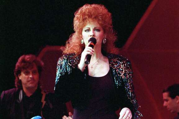 02/26/1989 - The world's largest rodeo crowd ever, 49,886, turned out for Sunday night's performance at the Houston Livestock Show and Rodeo featuring singer Reba McIntire.