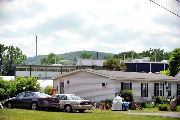 The Saint-Gobain Performance Plastics plant is seen behind homes along Carey Ave. on Tuesday, June 28, 2016, in Hoosick Falls, N.Y.    (Paul Buckowski / Times Union)