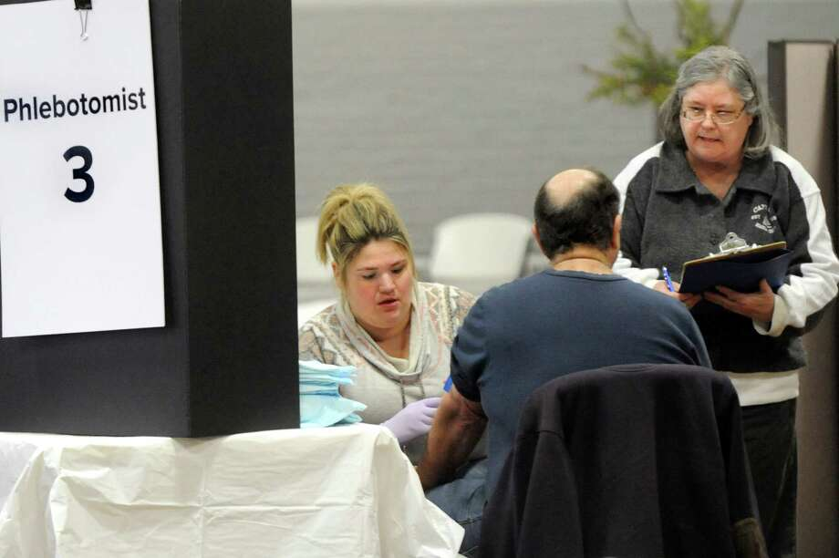 The Department of Health takes blood samples from residents to have it tested for PFOA contamination on Thursday, Feb. 18, 2016, at HAYC3 Armory in Hoosick Falls, N.Y. (Cindy Schultz / Times Union) Photo: Cindy Schultz / Albany Times Union