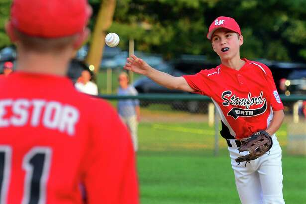 Stamford North second baseman Connor Sullivan throws to first base during Friday's Little League championship against Faifield American.