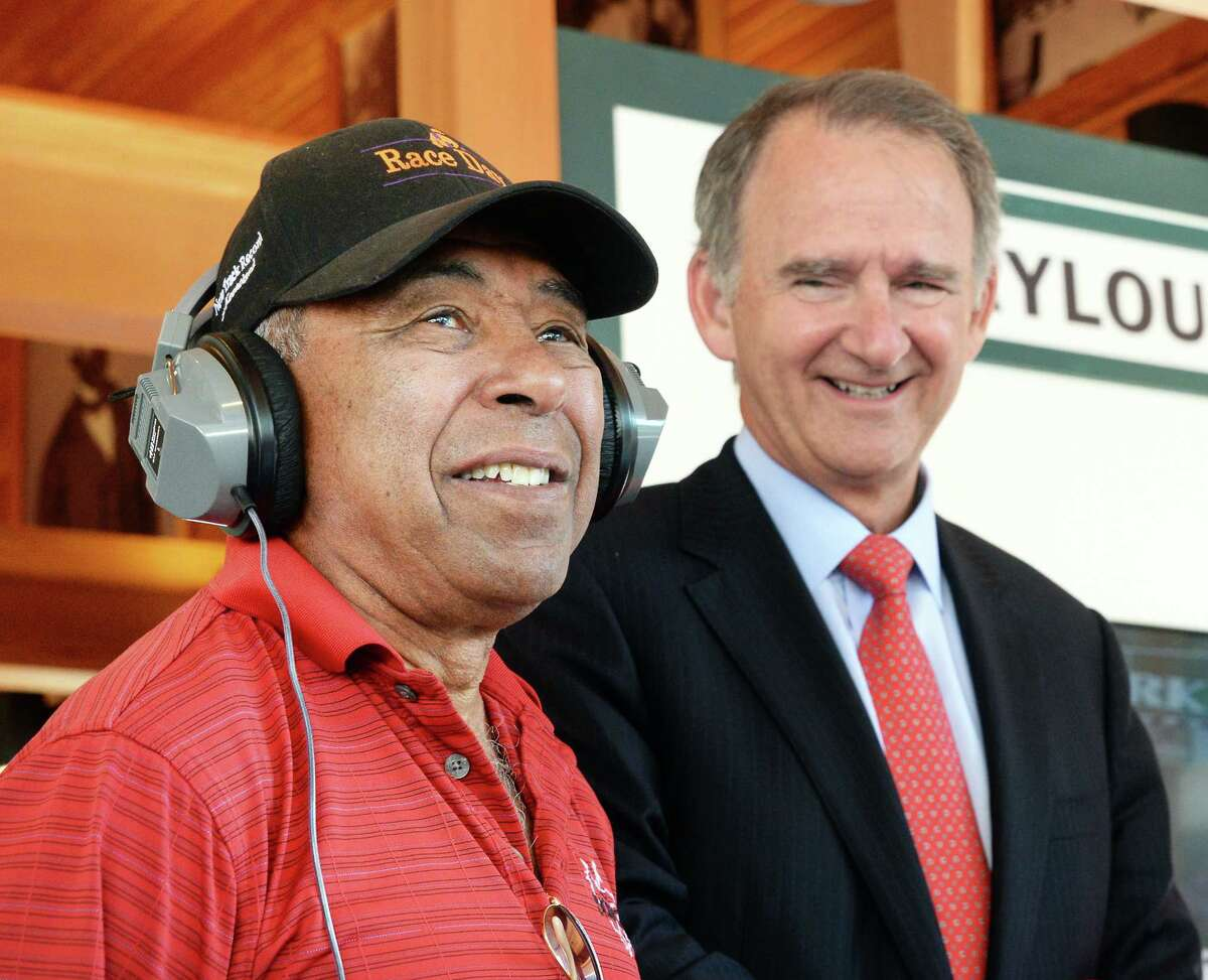 Hall of Fame jockey Angel Cordero, left, and NYRA CEO and president Chris Kay during a news conference to unveil a digital display in the Saratoga Walk of Fame on opening day at Saratoga Race Course Friday July 22, 2016 in Saratoga Springs, NY. (John Carl D'Annibale / Times Union)