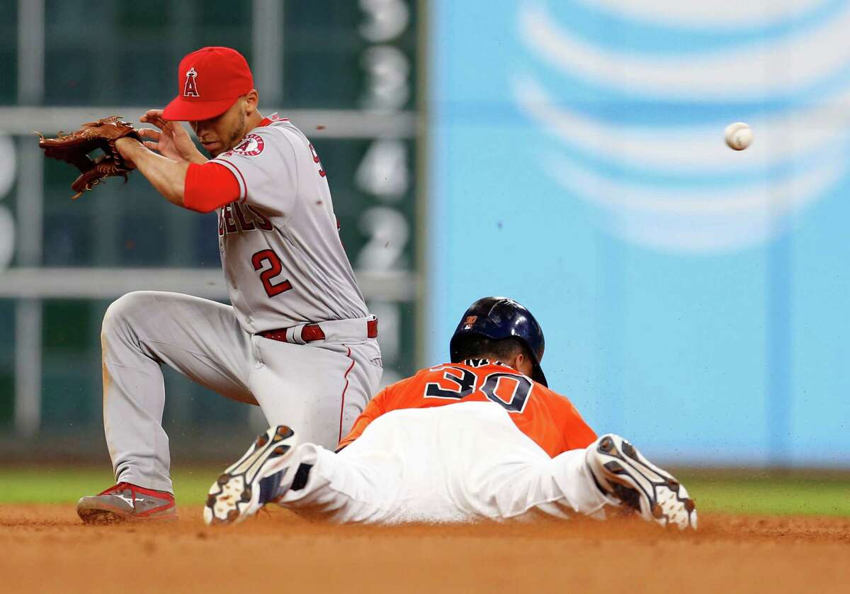 Houston Astros Carlos Gomez (30) steals second base from Los Angeles Angels shortstop Andrelton Simmons (2) during the seventh inning of an MLB baseball game at Minute Maid Park, Friday, July 22, 2016, in Houston.