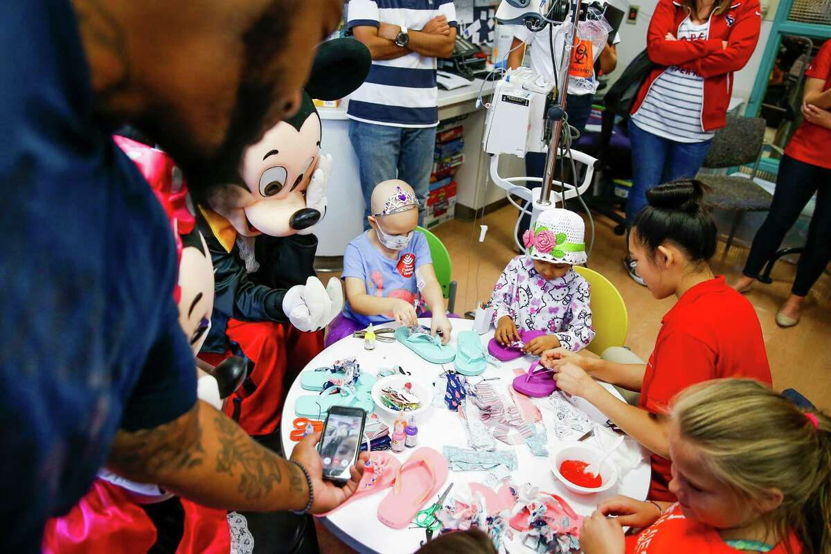 Houston Texans defensive end Devon Still facetimes with his daughter, Leah Still, to show her the sandals he made her during a visit with kids with cancer at the Texas Children's Hospital Friday, July 22, 2016. Still's daughter was diagnosed with neuroblastoma in 2014 and just beat the rare form of cancer earlier this year. Still and Leah created the Still Strong Foundation to provide financial support to families with children battling cancer.