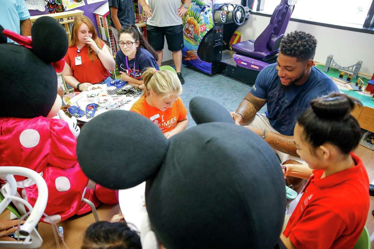 Houston Texans defensive end Devon Still, right, visits kids with cancer at the Texas Children's Hospital Friday, July 22, 2016. Still's daughter, Leah Still, was diagnosed with neuroblastoma in 2014 and just beat the rare form of cancer earlier this year. Still and Leah created the Still Strong Foundation to provide financial support to families with children battling cancer.