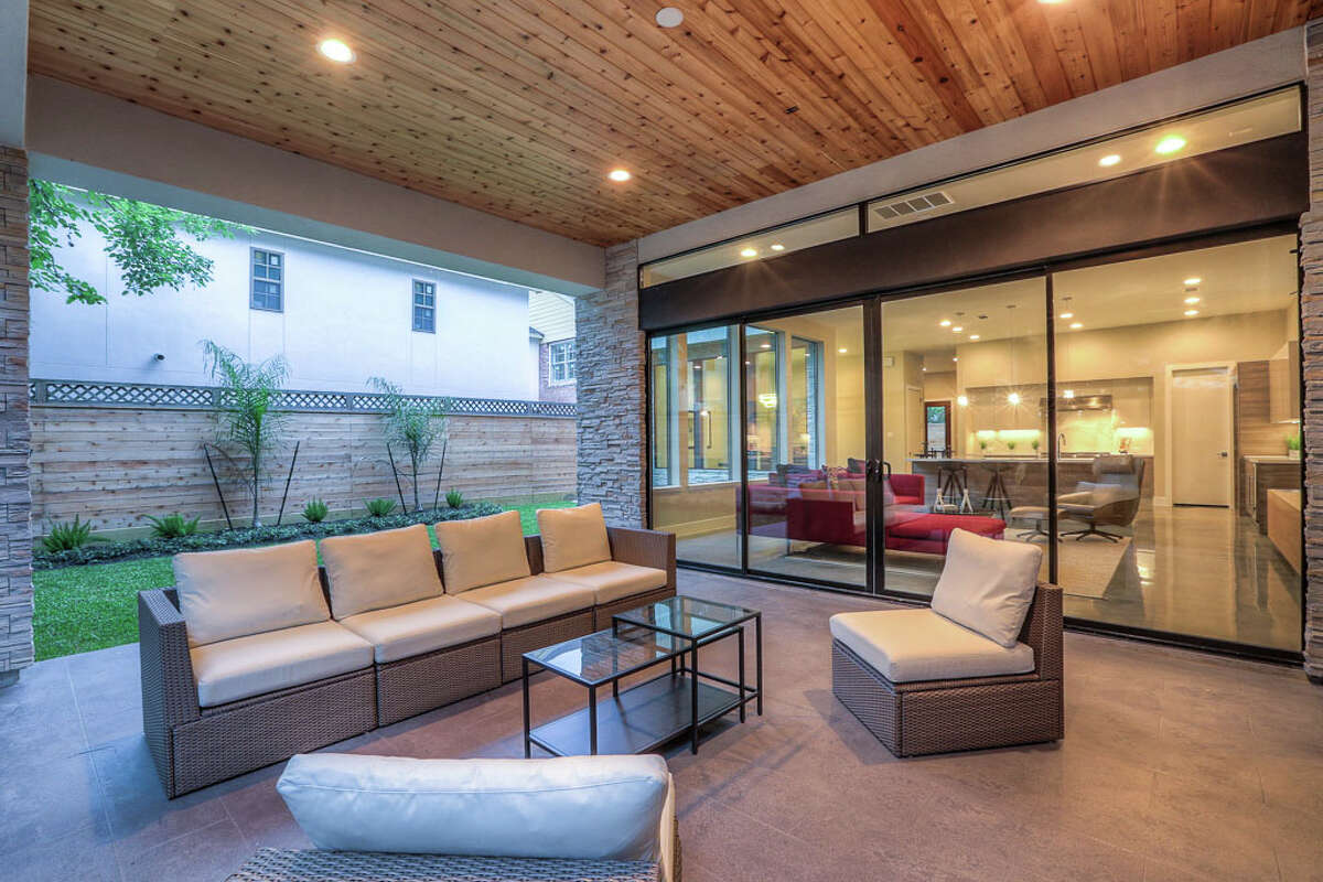 Blending indoor and outdoor spaces is part of the design in this home by On Point Custom Homes.