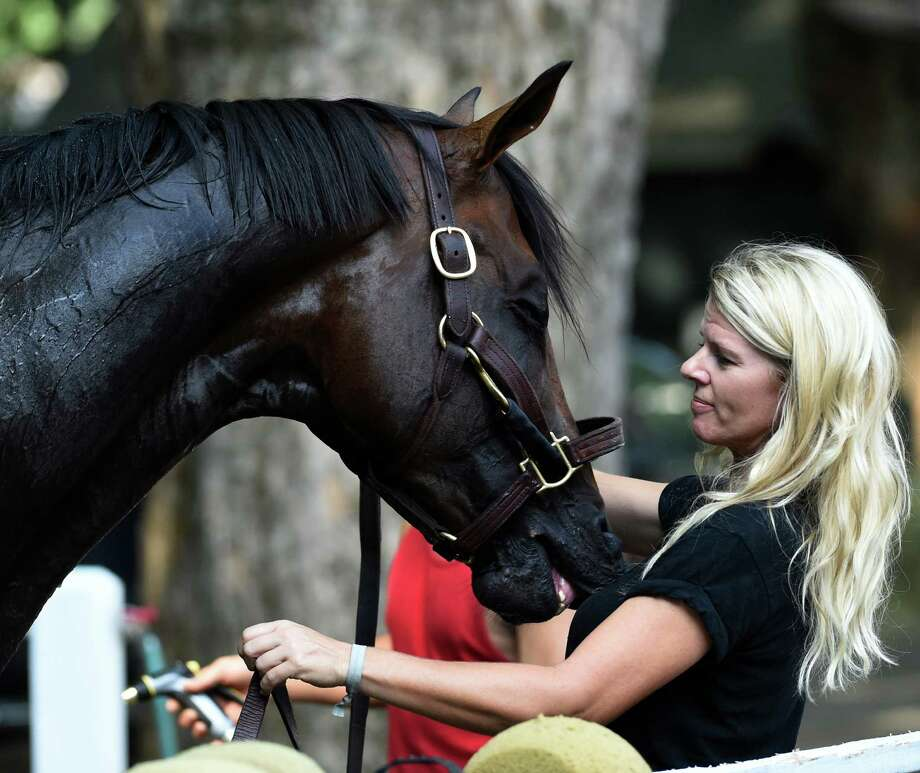 Julie Clark, assistant to trainer Keith Desormeaux holds a very sharp Preakness winner Exaggerator after his work at this morning the Saratoga Race Course Friday July 23 2016 in Saratoga Springs, N.Y.   (Skip Dickstein/Times Union) Photo: SKIP DICKSTEIN