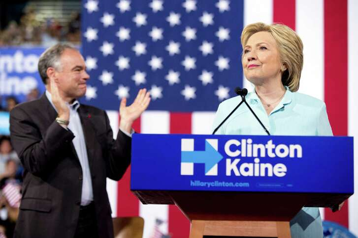 Democratic presidential candidate Hillary Clinton accompanied by Sen. Tim Kaine, D-Va., left, speaks at a rally at Florida International University Panther Arena in Miami, Saturday, July 23, 2016. Clinton has chosen Kaine to be her running mate.