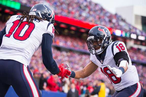 ORCHARD PARK, NY - DECEMBER 06:  Cecil Shorts #18 of the Houston Texans congratulates DeAndre Hopkins #10 on a touchdown reception against the Buffalo Bills on December 6, 2015 at Ralph Wilson Stadium in Orchard Park, New York.  Buffalo defeats Houston 30-21.  (Photo by Brett Carlsen/Getty Images)